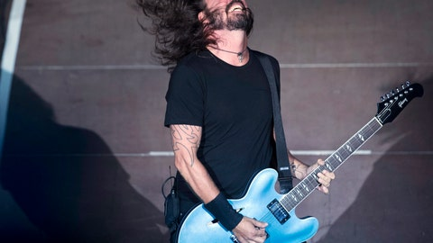 <p>               FILE- In this July 10, 2017, file photo,  the Foo Fighters' Dave Grohl performs in the ancient theatre of Herodes Atticus under the Acropolis in Athens. The  Foo Fighters will headline a pre-Super Bowl concert in Atlanta. News outlets report the 12-time Grammy award-winning group will headline the DirecTV Super Saturday Night concert Feb. 2, 2018, at a temporary venue to be constructed on site at Atlantic Station. (AP Photo/Petros Giannakouris, File)             </p>