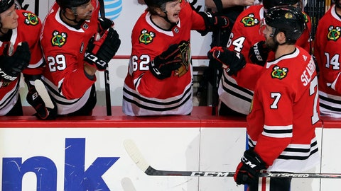 <p>               Chicago Blackhawks defenseman Brent Seabrook (7) is congratulated by teammates after his goal during the second period of an NHL hockey game against the St. Louis Blues, Wednesday, Nov. 14, 2018, in Chicago. (AP Photo/Nam Y. Huh)             </p>
