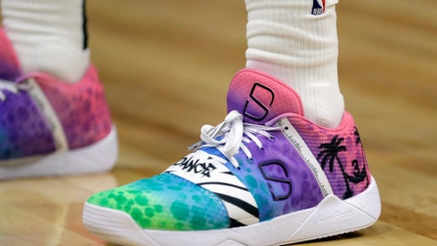 <p>               Brooklyn Nets' Spencer Dinwiddie wears shoes as a tribute to Miami Heat's Dwyane Wade during the second half of an NBA basketball game against the Miami Heat, Tuesday, Nov. 20, 2018, in Miami. The Nets won 104-92. This is Wade's last season. (AP Photo/Lynne Sladky)             </p>