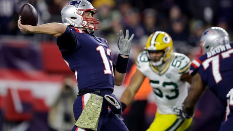 <p>               New England Patriots quarterback Tom Brady, left, passes under pressure from Green Bay Packers outside linebacker Nick Perry (53) during the first half of an NFL football game, Sunday, Nov. 4, 2018, in Foxborough, Mass. (AP Photo/Charles Krupa)             </p>
