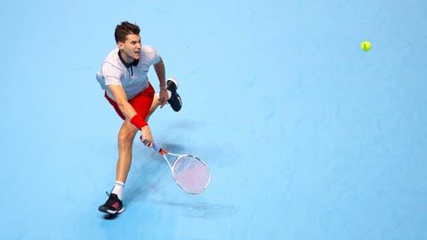 <p>               Austria's Dominic Thiem returns to Japan's Kei Nishikori during their men's singles match on day five of the ATP Finals at The O2 Arena, London, Thursday Nov. 15, 2018. (John Walton/PA via AP)             </p>