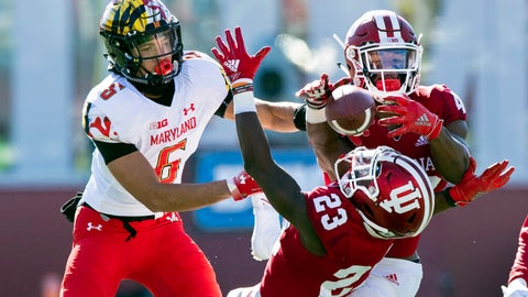 <p>               Indiana defensive back Jaylin Williams (23) and defensive back Marcelino Ball (42) battle to grab a pass intended for Maryland wide receiver Jeshaun Jones (6) during the first half of an NCAA college football game Saturday, Nov. 10, 2018, in Bloomington, Ind. (AP Photo/Doug McSchooler)             </p>