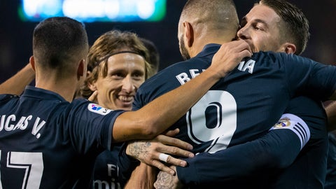 <p>               Real Madrid's Karim Benzema is congratulated by teammates after scoring a goal during a Spanish La Liga soccer match between RC Celta and Real Madrid at the Balaidos stadium in Vigo, Spain, Sunday, November 11, 2018. (AP Photo/Lalo R. Villar)             </p>