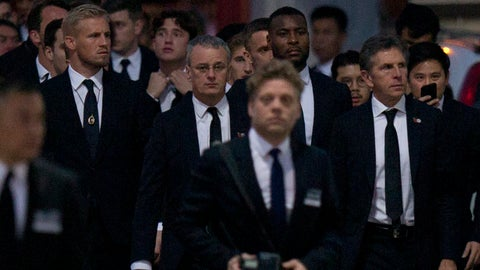 <p>               Players and officials of the English Premier League club Leicester City arrive at a Buddhist temple to participate in the funeral rituals of Vichai Srivaddhanaprabha in Bangkok, Thailand, Sunday, Nov. 4, 2018. An elaborate funeral began Saturday for Thai billionaire and Leicester City owner Vichai Srivaddhanaprabha, who died last week when his helicopter crashed in a parking lot next to the English Premier League club's stadium. (AP Photo/Gemunu Amarasinghe)             </p>