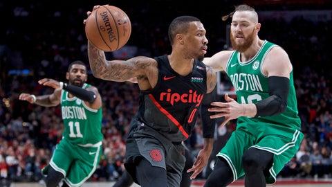 <p>               Portland Trail Blazers guard Damian Lillard, left, dribbles past Boston Celtics center Aron Baynes during the first half of an NBA basketball game in Portland, Ore., Sunday, Nov. 11, 2018. (AP Photo/Craig Mitchelldyer)             </p>