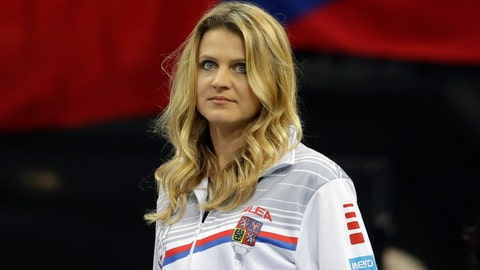 <p>               Tennis player Lucie Safarova of the Czech Republic watches a tennis match of the Fed Cup Final between Czech Republic and United States in Prague, Czech Republic, Saturday, Nov. 10, 2018. Former French Open finalist Lucie Safarova said on Saturday that she is planning to retire after the Australian Open. (AP Photo/Petr David Josek)             </p>