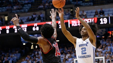 <p>               North Carolina guard Coby White (2) shoots while St. Francis guard Keith Braxton (13) defends during the first half of an NCAA college basketball game in Chapel Hill, N.C., Monday, Nov. 19, 2018. (AP Photo/Gerry Broome)             </p>