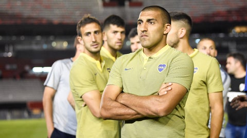 <p>               Ramón Abila of Argentina's Boca Juniors waits with his team on the pitch of the Antonio Vespucio Liberti stadium after the final soccer match of the Copa Libertadores was rescheduled for Sunday, in Buenos Aires, Argentina, Saturday, Nov. 24, 2018. The match was rescheduled after the bus carrying the Boca Juniors players was attacked by River Plate fans, injuring several players including Perez. (AP Photo/Gustavo Garello)             </p>
