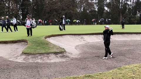 <p>               Tyrrell Hatton of England, bottom right, plays out a fairway bunker on the first hole during the second round of the World Cup of Golf tournament at the Metropolitan Golf Club in Melbourne, Australia, Friday, Nov. 23, 2018. Hatton and his partner, Ian Poulter, are playing South Korea's Byeong Hun An and Si Woo Kim. (AP Photo/Dennis Passa)             </p>