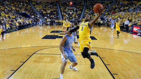 <p>               Michigan guard Zavier Simpson (3) drives on North Carolina forward Luke Maye (32) in the first half of an NCAA college basketball game in Ann Arbor, Mich., Wednesday, Nov. 28, 2018. (AP Photo/Paul Sancya)             </p>