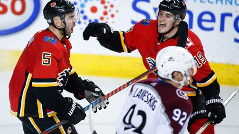<p>               Calgary Flames defenseman Mark Giordano (5) celebrates his goal with teammate Matthew Tkachuk during the third period of an NHL hockey game against the Colorado Avalanche on Thursday, Nov. 1, 2018, in Calgary, Alberta. (Jeff McIntosh/The Canadian Press via AP)             </p>