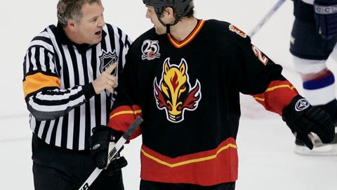 <p>               FILE - In this Dec. 23, 2005, file photo referee Mick McGeough, right, explains his penalty call on Calgary Flames' Marcus Nilson during the first period of NHL hockey action against the Vancouver Canucks in Vancouver, British Columbia. The NHL said in a statement Saturday, Nov. 24, 2018, that McGeough, a former NHL referee, died Friday night in Regina, Saskatchewan.  He was 62. McGeough worked 21 seasons from 1987 through 2008, refereeing 1,083 regular-season games and 63 playoff games. He was one of the last referees to officiate without a helmet.  (AP Photo/Richard Lam, File)             </p>