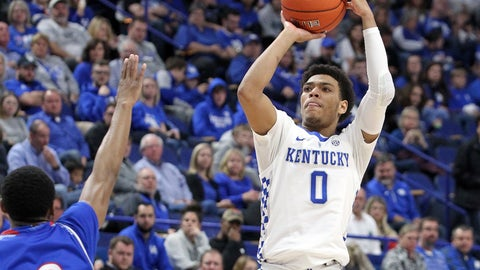 <p>               Kentucky's Quade Green, right, shoots while defended by Tennessee State's Armani Chaney during the second half of an NCAA college basketball game in Lexington, Ky., Friday, Nov. 23, 2018. (AP Photo/James Crisp)             </p>