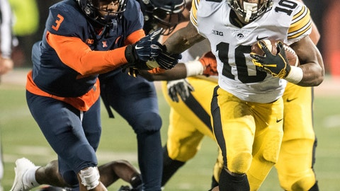 <p>               Iowa's Mekhi Sargent (10) breaks the tackle of Illinois 'Del'Shawn Phillips (3) in the second half of a NCAA college football game, Saturday, Nov. 17, 2018, in Champaign, Ill. (AP Photo/Holly Hart)             </p>