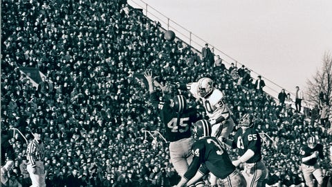 <p>               FILE - In this Nov. 23, 1968 file photo, Harvard's Tom Wynne (45), Yale's Cal Hill (3) and Harvard's Pat Conway (34) battle for a Yale pass during a college football game at Harvard Stadium in Cambridge, Mass. Sixty-five members of Harvard's 1968 football team are expected back on campus this weekend for the 50th anniversary of The Game's most memorable edition.  (AP Photo/File)             </p>