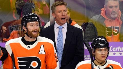 <p>               Philadelphia Flyers coach Dave Hakstol, center, calls out to his team during the first period of an NHL hockey game against the Ottawa Senators, Tuesday, Nov. 27, 2018, in Philadelphia. The Senators won 4-3. (AP Photo/Derik Hamilton)             </p>