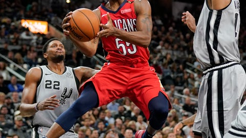 <p>               New Orleans Pelicans' E'Twaun Moore (55) looks to pass as he drives between San Antonio Spurs' LaMarcus Aldridge, right, and Rudy Gay during the first half of an NBA basketball game, Saturday, Nov. 3, 2018, in San Antonio. (AP Photo/Darren Abate)             </p>