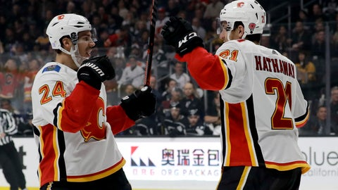 <p>               Calgary Flames defenseman Travis Hamonic, left, celebrates after scoring with right wing Garnet Hathaway during the first period of an NHL hockey game against the Los Angeles Kings in Los Angeles, Saturday, Nov. 10, 2018. (AP Photo/Chris Carlson)             </p>