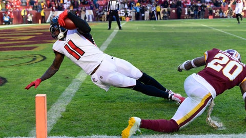 <p>               Atlanta Falcons wide receiver Julio Jones (11) dives past Washington Redskins free safety Ha Ha Clinton-Dix (20) and into the end zone for a touchdown during the second half of an NFL football game, Sunday, Nov. 4, 2018, in Landover, Md. (AP Photo/Susan Walsh)             </p>