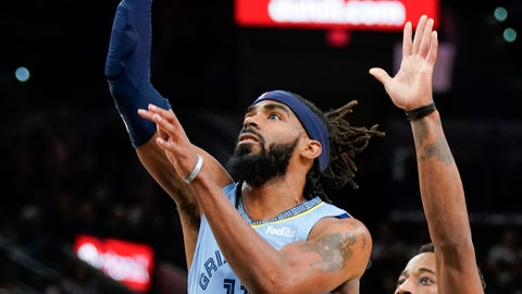 <p>               Memphis Grizzlies' Mike Conley (11) shoots ahead of San Antonio Spurs' DeMar DeRozan during the first half of an NBA basketball game Wednesday, Nov. 21, 2018, in San Antonio. (AP Photo/Darren Abate)             </p>