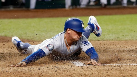 <p>               FILE - In this Sept. 24, 2018 file photo Los Angeles Dodgers' Tim Locastro slides across home plate to score a run against the Arizona Diamondbacks during the seventh inning of a baseball game in Phoenix. Locastro was acquired by the New York Yankees from the Los Angeles Dodgers, Wednesday, Nov. 21, 2018, for minor league right-hander Drew Finley and cash. (AP Photo/Ross D. Franklin, file)             </p>