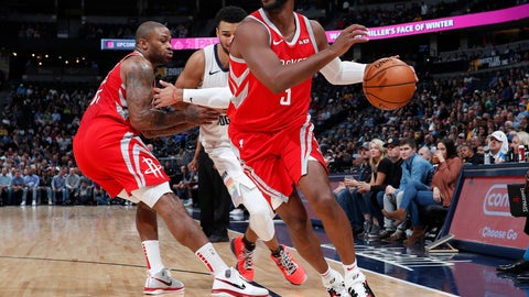<p>               Houston Rockets guard Chris Paul, front, drives to the basket as forward PJ Tucker, back left, blocks Denver Nuggets guard Jamal Murray in the first half of an NBA basketball game, Tuesday, Nov. 13, 2018, in Denver. (AP Photo/David Zalubowski)             </p>