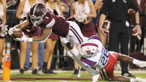 <p>               Mississippi State wide receiver Stephen Guidry (1) dives into the end zone for a touchdown as Louisiana Tech safety Jordan Baldwin (28) tries to stop him during the first half of an NCAA college football game on Saturday, Nov. 3, 2018, in Starkville, Miss. (AP Photo/Jim Lytle)             </p>