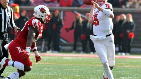 <p>               North Carolina State quarterback Ryan Finley (15) attempts a pass while under pressure from Louisville defensive end Amonte Caban (53) during the second half of an NCAA college football game, in Louisville, Ky., Saturday, Nov. 17, 2018. North Carolina State won 52-10. (AP Photo/Timothy D. Easley)             </p>