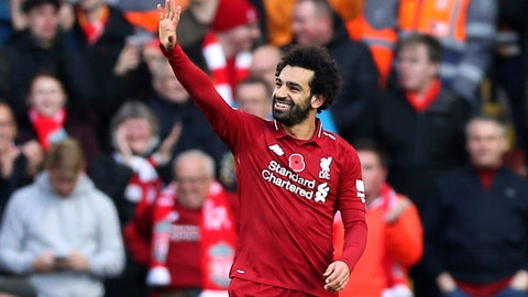 <p>               Liverpool's Mohamed Salah celebrates scoring his side's first goal of the game during the English Premier League soccer match between Liverpool and Fulham, at Anfield Stadium, in Liverpool, England, Sunday, Nov. 11, 2018. (Barrington Coombs/PA via AP)             </p>