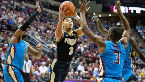 <p>               Purdue guard Carsen Edwards shoots between Florida State guards PJ Savoy, left, and Trent Forrest during the first half of an NCAA college basketball game in Tallahassee, Fla., Wednesday, Nov. 28, 2018. (AP Photo/Mark Wallheiser)             </p>