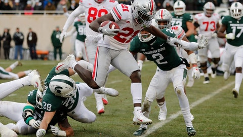 <p>               Ohio State wide receiver Parris Campbell (21) leaps over Michigan State linebacker Byron Bullough (38) to score on a 1-yard run during the first half of an NCAA college football game, Saturday, Nov. 10, 2018, in East Lansing, Mich. (AP Photo/Carlos Osorio)             </p>