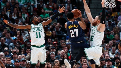<p>               Denver Nuggets guard Jamal Murray, center, goes up for a basket between Boston Celtics guard Kyrie Irving, left, and center Aron Baynes in the second half of an NBA basketball game, Monday, Nov. 5, 2018, in Denver. The Nuggets won 115-107. (AP Photo/David Zalubowski)             </p>