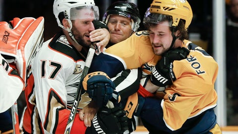 <p>               Anaheim Ducks center Ryan Kesler (17) and Nashville Predators left wing Filip Forsberg (9), of Sweden, fight as linesman Jonny Murray, center, tries to pull them apart during the second period of an NHL hockey game Sunday, Nov. 25, 2018, in Nashville, Tenn. (AP Photo/Mark Humphrey)             </p>