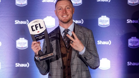 <p>               Calgary Stampeders quarterback Bo Levi Mitchell, named Most Outstanding Player, holds his award during the Canadian Football League awards in Edmonton, Alberta, Thursday, Nov. 22, 2018. (Jason Franson./The Canadian Press via AP)             </p>