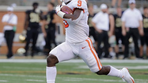 <p>               FILE - In this Oct. 6, 2018, file photo, Clemson's Travis Etienne runs for a touchdown against Wake Forest during an NCAA college football game in Charlotte, N.C. Etienne is the one running back left who might be able to break into the field of Heisman Trophy candidates. His biggest issue is touches. The sophomore is averaging just under 13 carries per game, but 8.6 yards per carry with 15 touchdowns. (AP Photo/Chuck Burton, File)             </p>