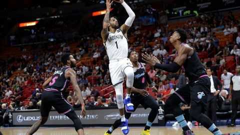 <p>               Brooklyn Nets' D'Angelo Russell (1) shoots over Miami Heat's Derrick Jones Jr. (5), Josh Richardson (0) and Hassan Whiteside, right, during the first half of an NBA basketball game, Tuesday, Nov. 20, 2018, in Miami. (AP Photo/Lynne Sladky)             </p>