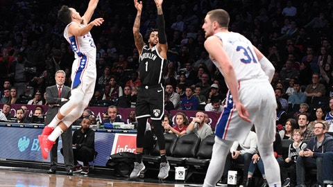<p>               Brooklyn Nets guard D'Angelo Russell (1) shoots a three-point goal past Philadelphia 76ers guard Landry Shamet (23) and forward Mike Muscala (31) during the second half of an NBA basketball game, Sunday, Nov. 4, 2018, in New York. (AP Photo/Kathleen Malone-Van Dyke)             </p>