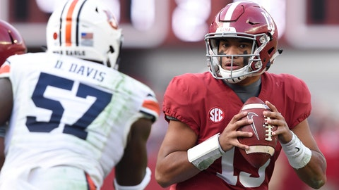 Nov 24, 2018; Tuscaloosa, AL, USA; Alabama Crimson Tide quarterback Tua Tagovailoa (13) rolls out to pass against the Auburn Tigers during the second quarter at Bryant-Denny Stadium. Mandatory Credit: John David Mercer-USA TODAY Sports