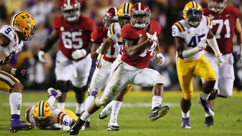 BATON ROUGE, LOUISIANA - NOVEMBER 03: Damien Harris #34 of the Alabama Crimson Tide avoids the tackle of Grant Delpit #9 of the LSU Tigers in the second quarter of their game at Tiger Stadium on November 03, 2018 in Baton Rouge, Louisiana. (Photo by Gregory Shamus/Getty Images)