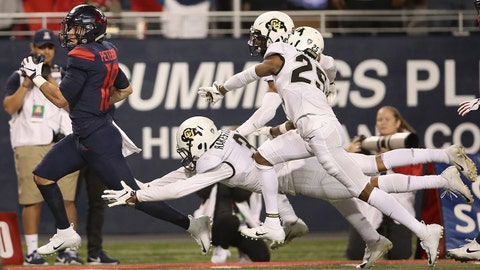 TUCSON, AZ - NOVEMBER 02:  Wide receiver Cedric Peterson #18 of the Arizona Wildcats runs with the football en route to scoring a 57 yard touchdown reception against the Colorado Buffaloes during the second half of the college football game at Arizona Stadium on November 2, 2018 in Tucson, Arizona.  (Photo by Christian Petersen/Getty Images)