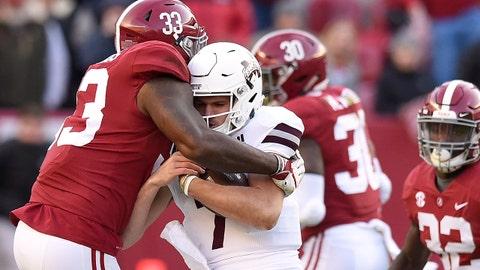 Nov 10, 2018; Tuscaloosa, AL, USA; Alabama Crimson Tide linebacker Anfernee Jennings (33) wraps up Mississippi State Bulldogs quarterback Nick Fitzgerald (7)  during the second quarter at Bryant-Denny Stadium. Mandatory Credit: John David Mercer-USA TODAY Sports