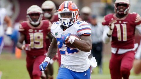 Nov 24, 2018; Tallahassee, FL, USA; Florida Gators running back Lamical Perine (22) breaks loose for long touchdown run in the first half against the Florida State Seminoles at Doak Campbell Stadium. Mandatory Credit: Glenn Beil-USA TODAY Sports