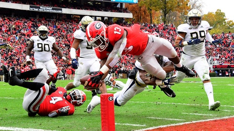 ATHENS, GA - NOVEMBER 24: Elijah Holyfield #13 of the Georgia Bulldogs scores a second quarter touchdown against the Georgia Tech Yellow Jackets on November 24, 2018 at Sanford Stadium in Athens, Georgia. (Photo by Scott Cunningham/Getty Images)