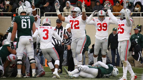 EAST LANSING, MI - NOVEMBER 10: Rocky Lombardi #12 of the Michigan State Spartans lays on the ground as the Ohio State Buckeyes celebrate a fourth quarter fumble recovery for a touchdown at Spartan Stadium on November 10, 2018 in East Lansing, Michigan. (Photo by Gregory Shamus/Getty Images)