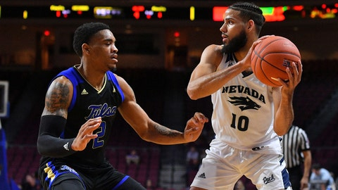 LAS VEGAS, NEVADA - NOVEMBER 22:  Caleb Martin #10 of the Nevada Wolf Pack looks to pass against DaQuan Jeffries #2 of the Tulsa Golden Hurricane during the 2018 Continental Tire Las Vegas Holiday Invitational basketball tournament at the Orleans Arena on November 22, 2018 in Las Vegas, Nevada.  (Photo by Sam Wasson/Getty Images)