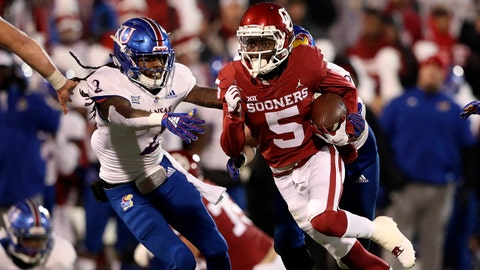 Nov 17, 2018; Norman, OK, USA; Oklahoma Sooners wide receiver Marquise Brown (5) runs past Kansas Jayhawks cornerback Corione Harris (2) during the first half at Gaylord Family - Oklahoma Memorial Stadium. Mandatory Credit: Kevin Jairaj-USA TODAY Sports