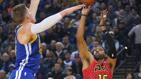 November 13, 2018; Oakland, CA, USA; Atlanta Hawks forward Vince Carter (15) shoots the basketball against Golden State Warriors forward Jonas Jerebko (21) during the first quarter at Oracle Arena. Mandatory Credit: Kyle Terada-USA TODAY Sports