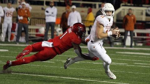 Nov 10, 2018; Lubbock, TX, USA; Texas Tech Red Raiders defensive back Jordyn Brooks (1) tackles Texas Longhorns quarterback Sam Ehlinger (11) in the first half at Jones AT&T Stadium. Mandatory Credit: Michael C. Johnson-USA TODAY Sports