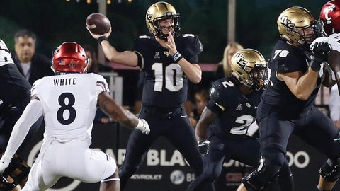 UCF quarterback McKenzie Milton (10) throws against Cincinnati during the first half at Spectrum Stadium in Orlando, Fla., on Saturday, Nov. 17, 2018. (Stephen M. Dowell/Orlando Sentinel/TNS via Getty Images)