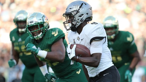 Nov 23, 2018; Tampa, FL, USA; UCF Knights running back Adrian Killins Jr. (9) runs the ball against the South Florida Bulls during the first quarter at Raymond James Stadium. Mandatory Credit: Kim Klement-USA TODAY Sports